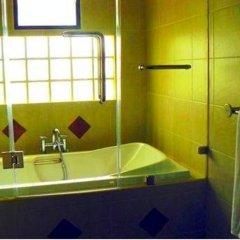 Апартаменты Rouge Service Apartment Паттайя ванная