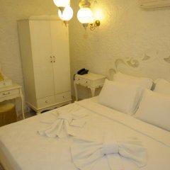 Отель Alacati Alanur Otel Чешме сейф в номере