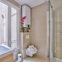 Апартаменты Family Apartment in Buttes Chaumont Париж ванная