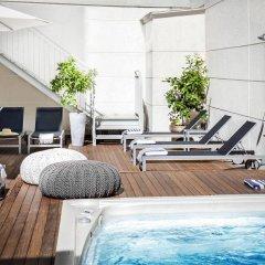 Отель Eric Vökel Boutique Apartments - Atocha Suites Испания, Мадрид - отзывы, цены и фото номеров - забронировать отель Eric Vökel Boutique Apartments - Atocha Suites онлайн бассейн