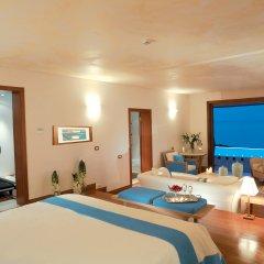 Отель Grand Resort Lagonissi комната для гостей