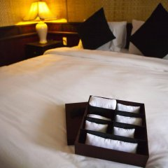 Отель Legend Halong Private Cruise сейф в номере