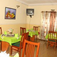 Отель Xcape Hotels and Suites Ltd Нигерия, Калабар - отзывы, цены и фото номеров - забронировать отель Xcape Hotels and Suites Ltd онлайн питание