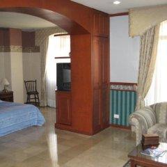 Отель Suites House Centenario Колумбия, Кали - отзывы, цены и фото номеров - забронировать отель Suites House Centenario онлайн комната для гостей