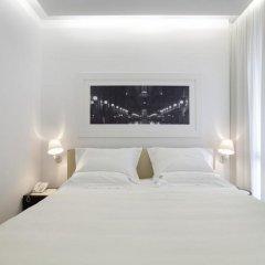 Отель UNAHOTELS Cusani Milano комната для гостей фото 2