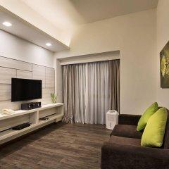 Апартаменты Orange Grove Service Apartment by ST Residences комната для гостей фото 4