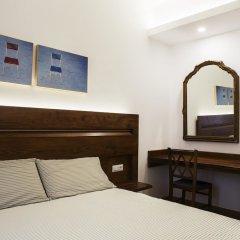 Отель Il Pettirosso B&B сейф в номере