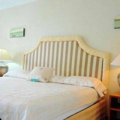 Отель Beachcombers Hotel Сент-Винсент и Гренадины, Остров Бекия - отзывы, цены и фото номеров - забронировать отель Beachcombers Hotel онлайн комната для гостей фото 4