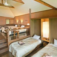 Отель Resonate Club Kuju Япония, Минамиогуни - отзывы, цены и фото номеров - забронировать отель Resonate Club Kuju онлайн комната для гостей