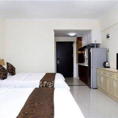 Апартаменты Xingfu Huafu Apartment комната для гостей фото 3
