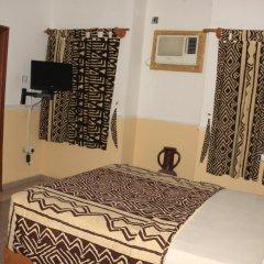 Отель Jacaranda Suites Нигерия, Калабар - отзывы, цены и фото номеров - забронировать отель Jacaranda Suites онлайн удобства в номере