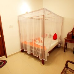 Отель Frangipani Motel удобства в номере
