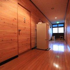 Отель Minshuku Miyanourasou Якусима комната для гостей