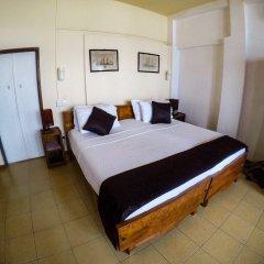 Отель Amor Villa сейф в номере