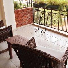 Отель Aparta Hotel Turey Доминикана, Санто Доминго - отзывы, цены и фото номеров - забронировать отель Aparta Hotel Turey онлайн балкон