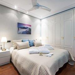 Апартаменты Alaia Holidays Apartments & Suite Carretas 33 комната для гостей