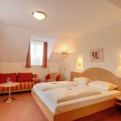 Отель Kriemhild am Hirschgarten Германия, Мюнхен - отзывы, цены и фото номеров - забронировать отель Kriemhild am Hirschgarten онлайн комната для гостей фото 4