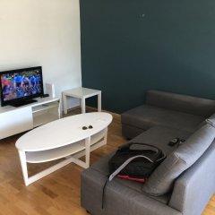 Апартаменты Kvadraturen Apartments Family Кристиансанд комната для гостей фото 2