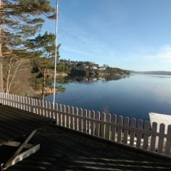 Отель Solferie Holiday Cabin Ålefjærveien Кристиансанд приотельная территория