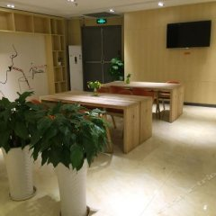 Отель 7 Days Premium (Chongqing Fuling Binjiang Avenue) Китай, Фулинь - отзывы, цены и фото номеров - забронировать отель 7 Days Premium (Chongqing Fuling Binjiang Avenue) онлайн интерьер отеля фото 3