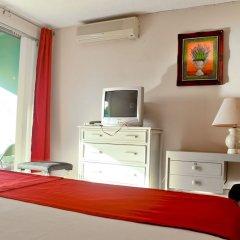 Отель Garden Beach Studios at Montego Bay Club Ямайка, Монтего-Бей - отзывы, цены и фото номеров - забронировать отель Garden Beach Studios at Montego Bay Club онлайн удобства в номере