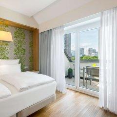 Отель NH Frankfurt Messe комната для гостей фото 5