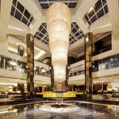 Отель Grand Millennium Hotel Kuala Lumpur Малайзия, Куала-Лумпур - отзывы, цены и фото номеров - забронировать отель Grand Millennium Hotel Kuala Lumpur онлайн интерьер отеля