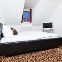 Отель Swiss Star Apartments Center Швейцария, Цюрих - отзывы, цены и фото номеров - забронировать отель Swiss Star Apartments Center онлайн комната для гостей фото 4