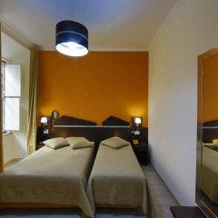 Отель Pensao Praca Da Figueira Лиссабон комната для гостей фото 3