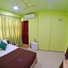 Отель Tourist Inn Мале комната для гостей фото 4