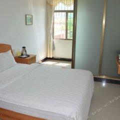 Zhengfei Hostel комната для гостей