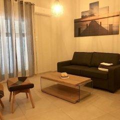 Апартаменты Well being apartment комната для гостей фото 5
