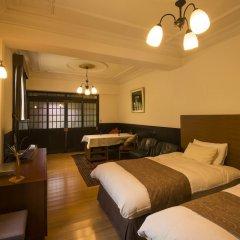 Отель Kurokawaso Минамиогуни комната для гостей