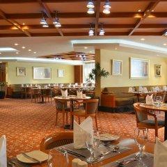 Отель Swiss-Belhotel Sharjah