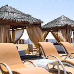 Отель Regency Sealine Camp Катар, Месайед - отзывы, цены и фото номеров - забронировать отель Regency Sealine Camp онлайн бассейн фото 2