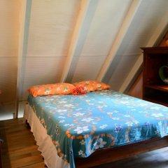Отель Maison Te Vini Holiday home 3 Французская Полинезия, Пунаауиа - отзывы, цены и фото номеров - забронировать отель Maison Te Vini Holiday home 3 онлайн комната для гостей фото 4