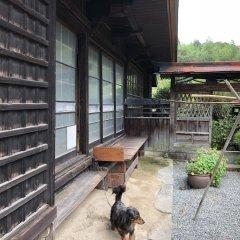 Отель Nouka Minpaku Seiryuan Япония, Минамиогуни - отзывы, цены и фото номеров - забронировать отель Nouka Minpaku Seiryuan онлайн балкон