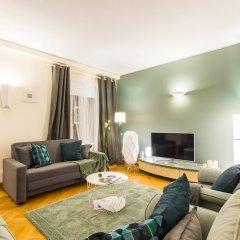 Апартаменты Big Italy Apartment 200m2 комната для гостей