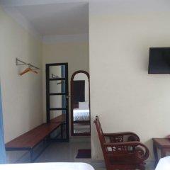 Отель Yellow House Homestay сейф в номере