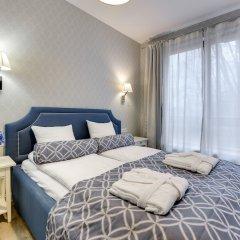 Апартаменты Lion Apartments -Aquarius Deluxe комната для гостей фото 2