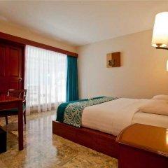 Отель White Rose Kuta Resort, Villas & Spa комната для гостей фото 4