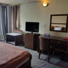 Отель The Camelot Rest House удобства в номере