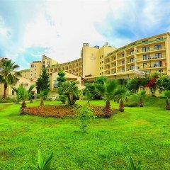 Отель Lyra Resort - All Inclusive Сиде вид на фасад