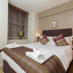 Отель Bright and Stylish Apartment - Old Town! Великобритания, Эдинбург - отзывы, цены и фото номеров - забронировать отель Bright and Stylish Apartment - Old Town! онлайн комната для гостей фото 2