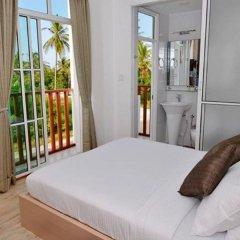 Отель Airport Comfort Inn Maldives Мале комната для гостей фото 2