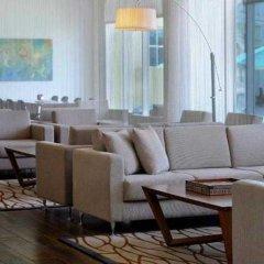 Отель Courtyard by Marriott Dubai Green Community интерьер отеля фото 3