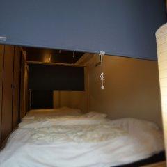 Отель Japanese Condominium UNO Ито комната для гостей