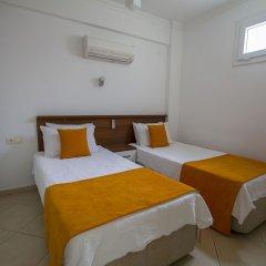 Infinity Olympia Apartments Турция, Олудениз - отзывы, цены и фото номеров - забронировать отель Infinity Olympia Apartments онлайн комната для гостей фото 2