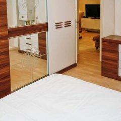 Отель Maya Aparts сейф в номере