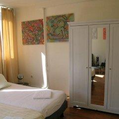 Отель Greenhouse Effect Нидерланды, Амстердам - отзывы, цены и фото номеров - забронировать отель Greenhouse Effect онлайн сейф в номере